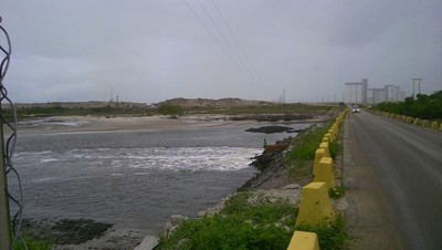 Access dam blocking the free flow of water in and out of the Tatuoca estuary