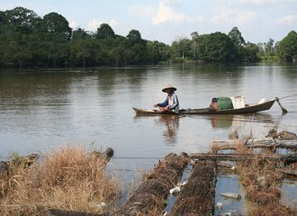 fisherman on the Kampar river, Indonesia