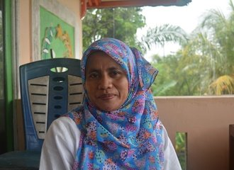 10 - Siti Hajar, a member of the Kampai women's group