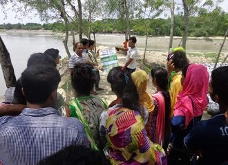 a Youth Water Committee visiting the riverside to discuss the gender differentiated impacts of waterlogging and climate change