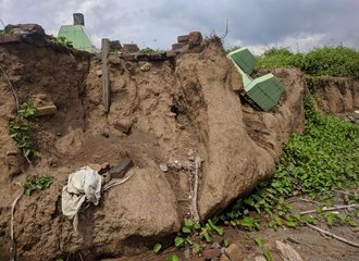 Cemetary along the coast south of Makassar destroyed by erosion