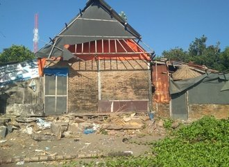 House along the coast damaged by intensfied erosion