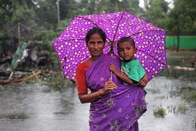 Mother and son in devastating heavy rain, Tamil Nadu, India