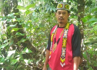 Dayak indigenous man in forest, Indonesia