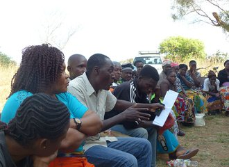 community meeting in Zambia on PLUP