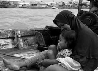 woman and child on boat_Indonesia_photo by Solidaritas Perempuan_smaller
